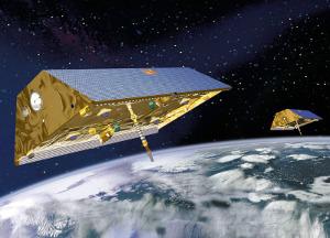 Dvojice družic GRACE na oběžné dráze (ilustrace NASA)